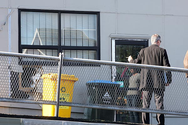 Police are examining a hole at the back of the Gillard Pharmacy building in Mt Albert.