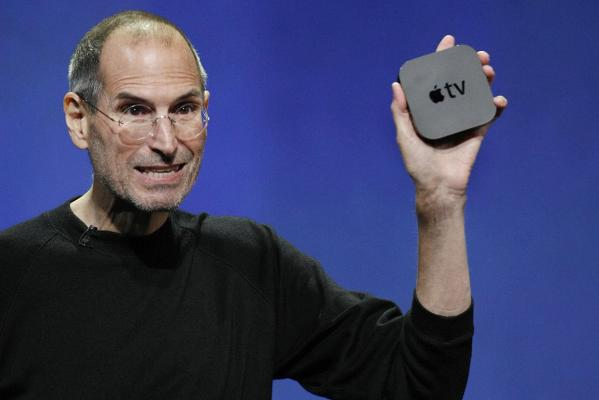 Steve Jobs displays the new Apple TV.