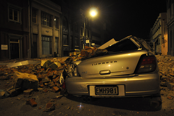 A car crushed by falling rubble from the earthquake.