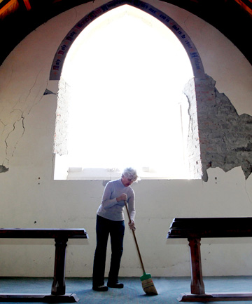 HEARTBREAKING: Rosemary Acland helps clear up the damage to The Church of the Holy Innocents at Mt Peel.