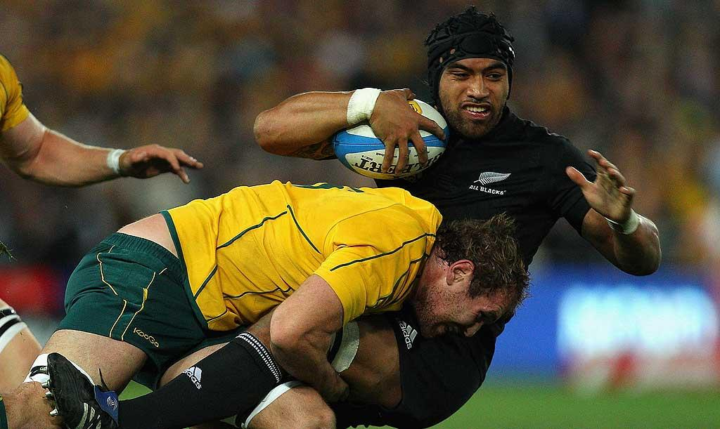 All Blacks loose forward Victor Vito is tackled by Rocky Elsom in the Bledisloe Cup match against Australia in Sydney.