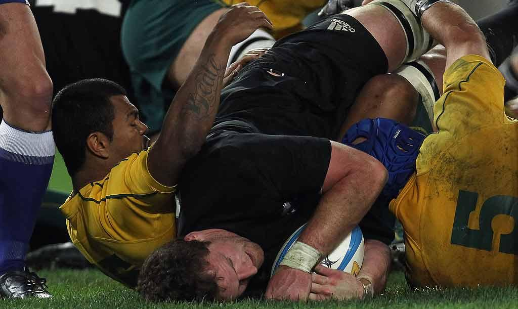 All Blacks No8 Kieran Read scores the side's matchwinning try against Australia at ANZ Stadium in Sydney.