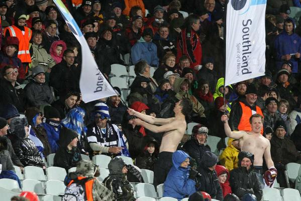 A pair of brave shirtless Southland supporters brave the cold during the team's successful defence of the Ranfurly Shield against Auckland in Invercargill.