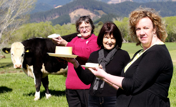 Farm produce: A steer observes Rai Valley cheese makers, from left, Elizabeth Della Bosca,  Faye Leov and Liz Downey display their goods.