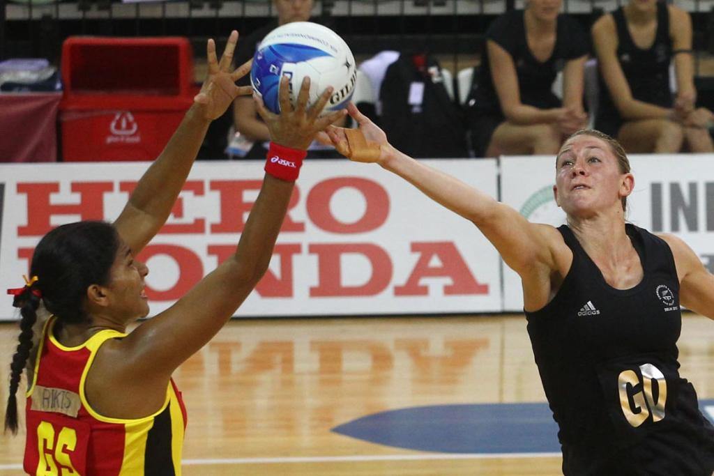Papua New Guinea's Lua Rikis and New Zealand's Casey Williams battle for the ball during the Silver Ferns' big win over Papua New Guinea at the Commonwealth Games in Delhi.