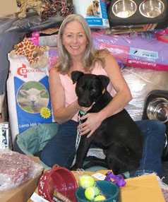 KIND DONATION: Linda Nunn from Animal Rehoming, pictured with another rescued dog Caesar, is thankful for Masterpet's large donation.
