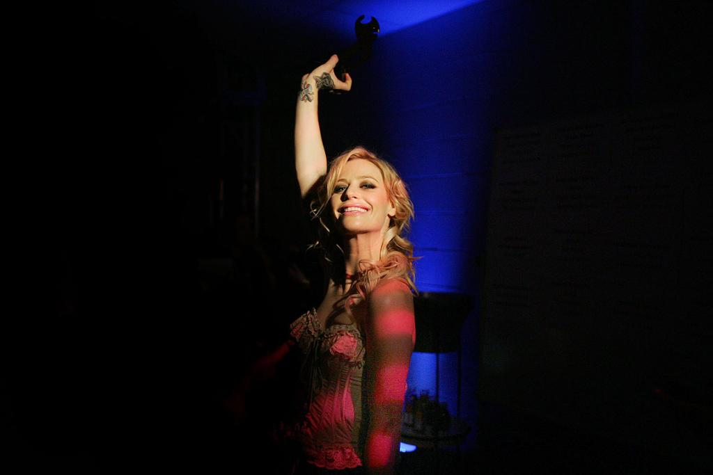 TIME FOR A GIN: Gin Wigmore celebrates one of the four Tuis she won at the New Zealand Music Awards.