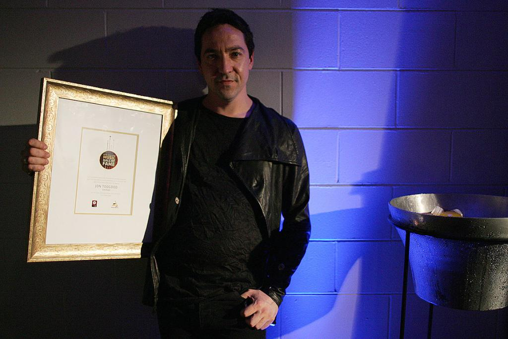 ROCK LEGENDS: Jon Toogood shows off his Legacy Award after Shihad were inducted in the Hall of Fame at the music awards.