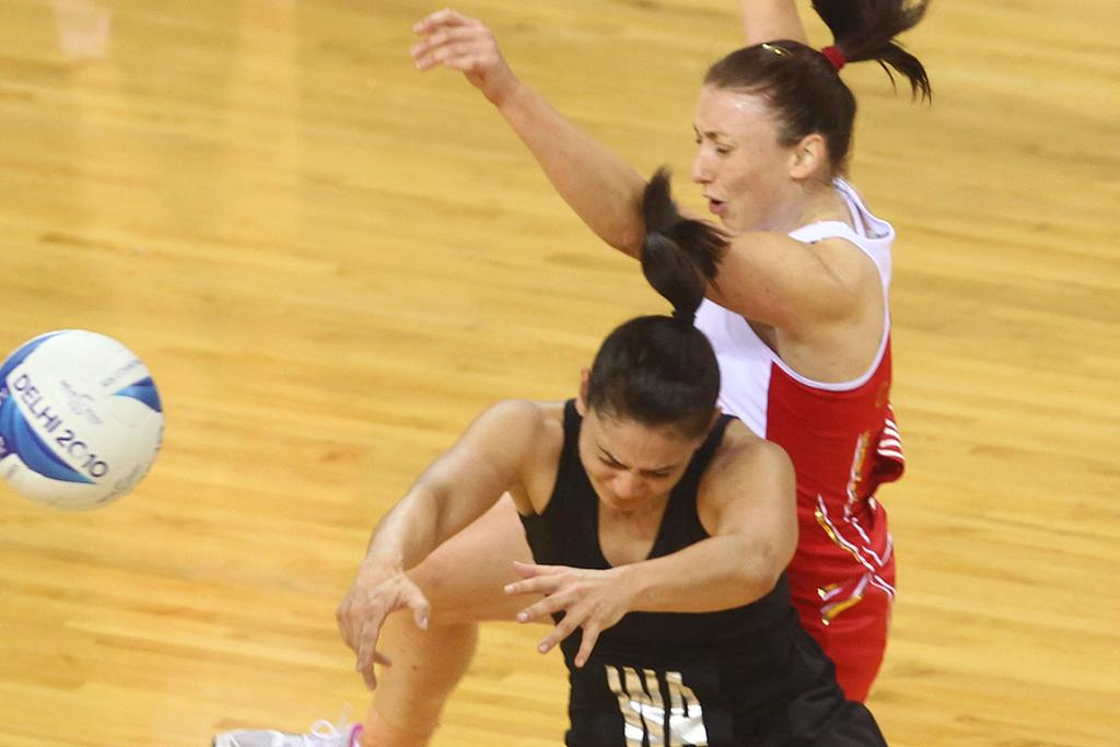 New Zealand's Temepara George and England's Jade Clarke collide during their netball clash in the Commonwealth Games.