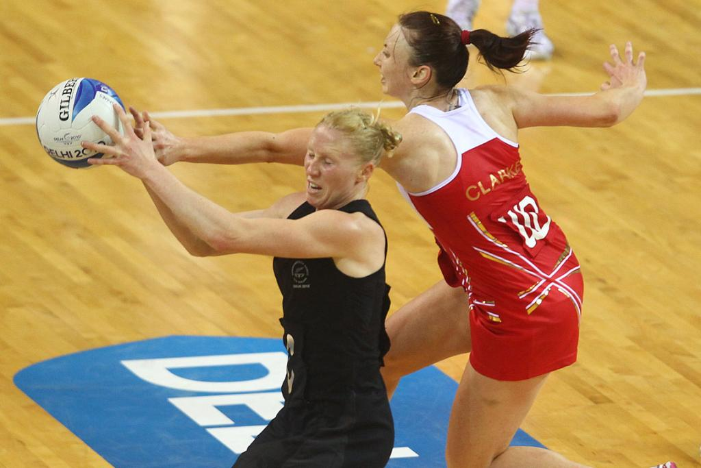 Laura Langman and Jade Clarke battle for possession in New Zealand's win over England at the Commonwealth Games.