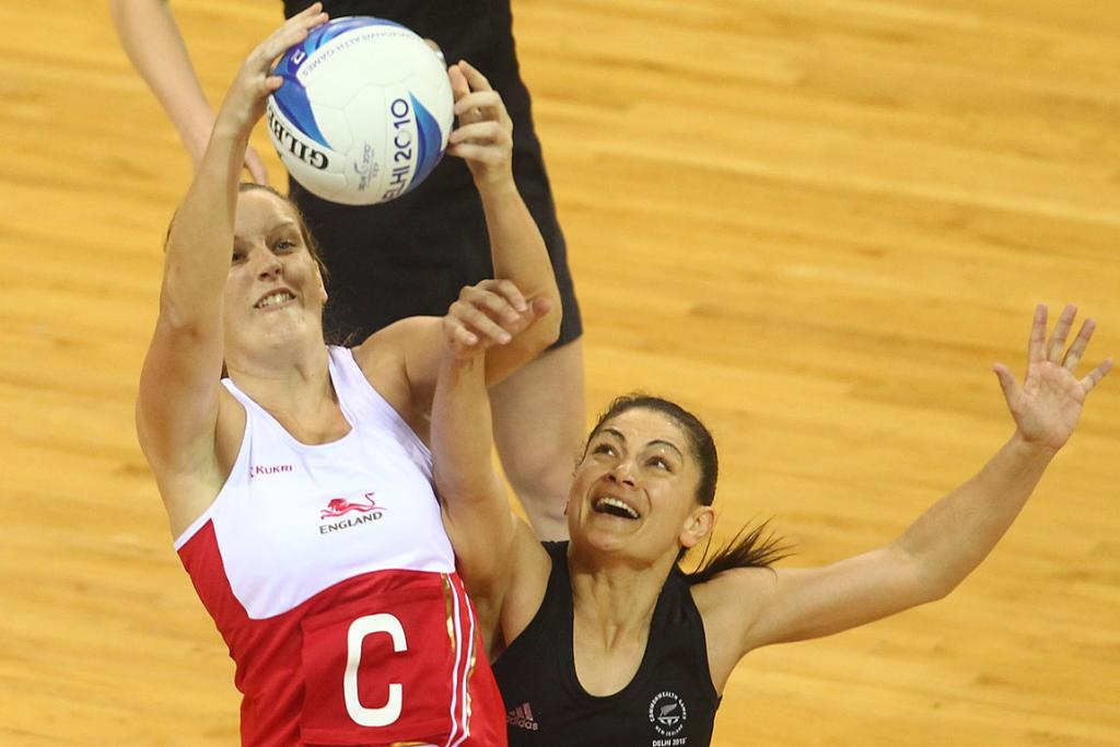 England's Sara Bayman beats New Zealand's Temepara George to the ball in the netball match won by New Zealand at the Commonwealth Games.