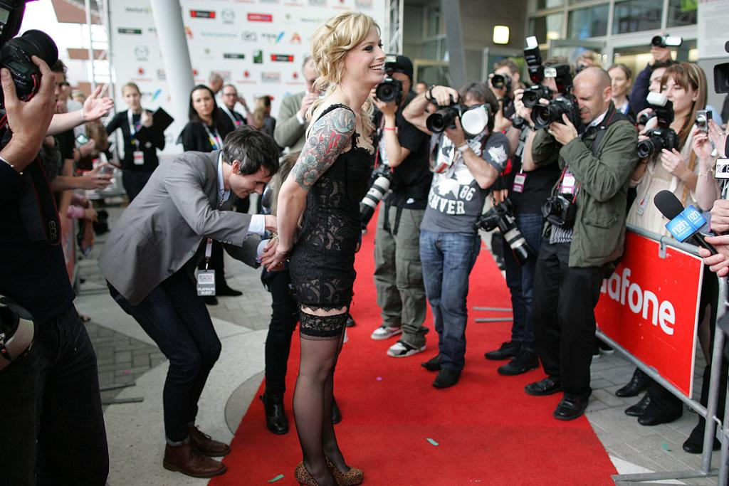 TAKE A PICTURE: Gin Wigmore has her outfit adjusted after arriving at the New Zealand Music Awards.