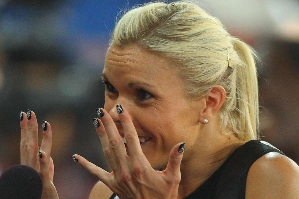 New Zealand's Monique Williams shows off her Silver Fern-painted fingernails after her 200m heat at the Delhi Commonwealth Games.