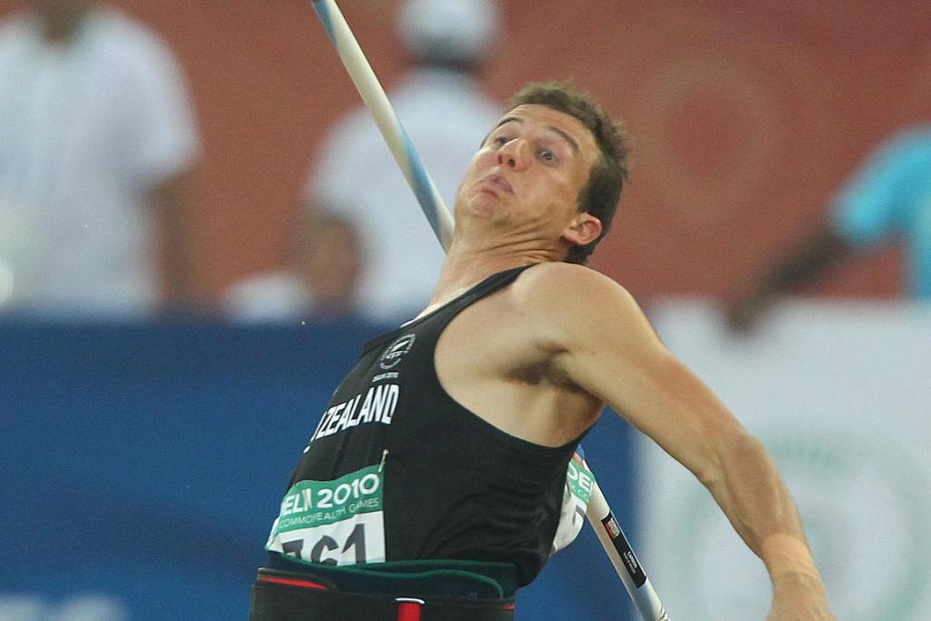 New Zealand's Brent Newdick competes in the javelin section on his way to silver in the decathlon at the Commonwealth Games in Delhi.