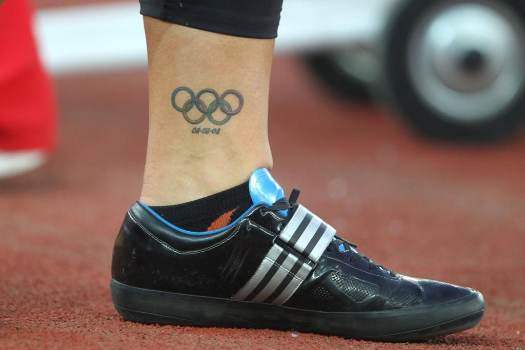 An Olympics tattoo on the leg of New Zealand's Valerie Adams as she competes in the shot put at the Commonwealth Games in Delhi.