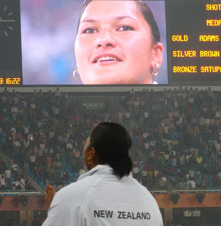 New Zealand's Valerie Adams is show on the big screen as she stands on the dias to receive her gold medal for winning the shot put at the Commonwealth Games in Delhi.