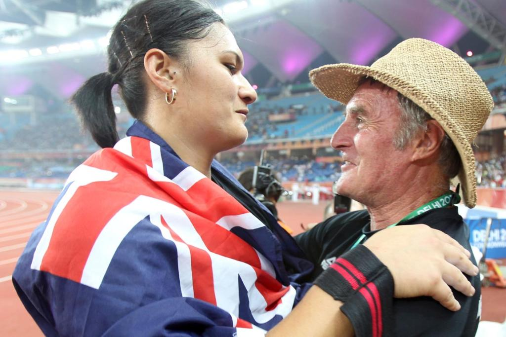New Zealand's Valerie Adams is congratulated by her coach coach Didier Poppe after winning the shot at the Commonwealth Games in Delhi.