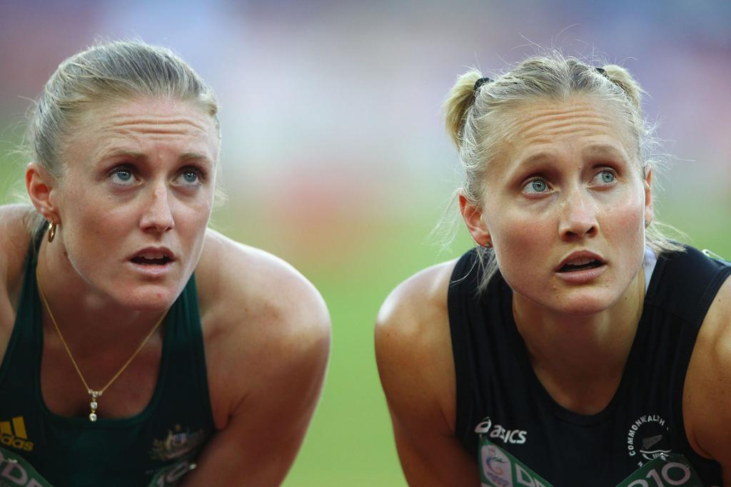 Australia's Sally Pearson (left) and New Zealand's Andrea Miller check their times after a heat of the 200 metre hurdles at the Commonwealth Games in Delhi.