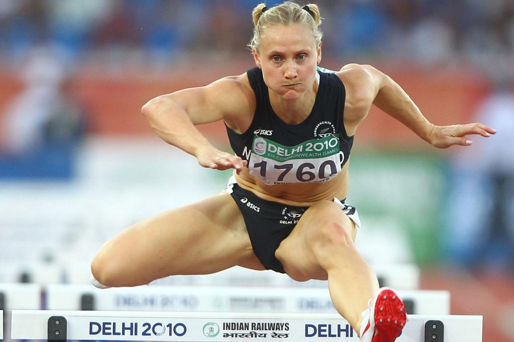 New Zealand's Andrea Miller competes in a heat of the 100 metre hurdles at the Commonwealth Games in Delhi.