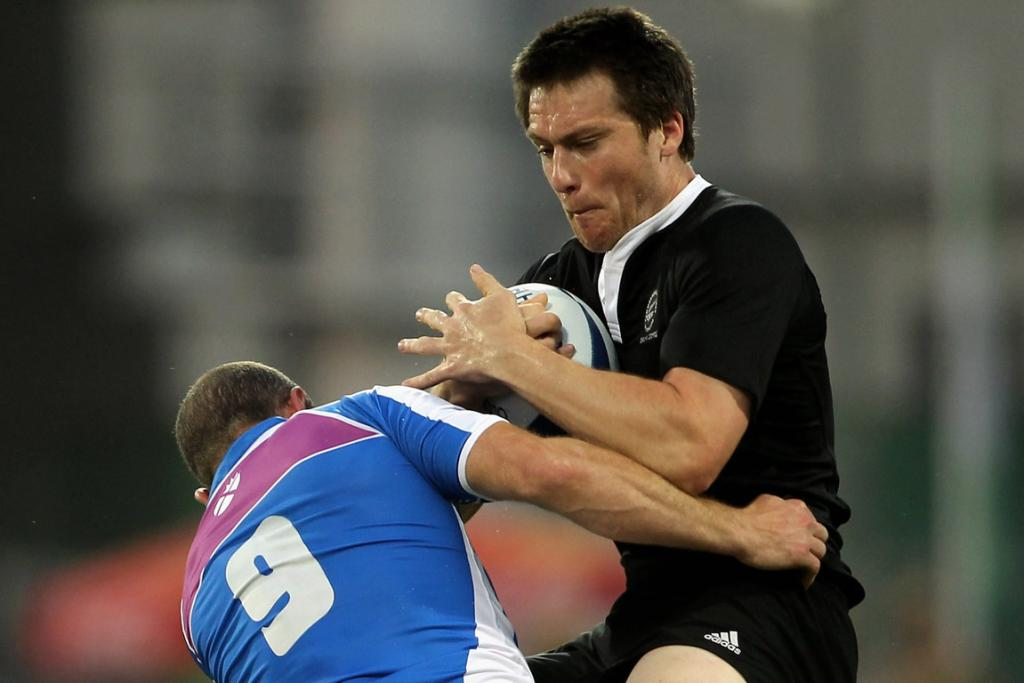 New Zealand's Ben Smith is tackled by a Scottish player in the Pool A sevens match at the Delhi Commonwealth Games.