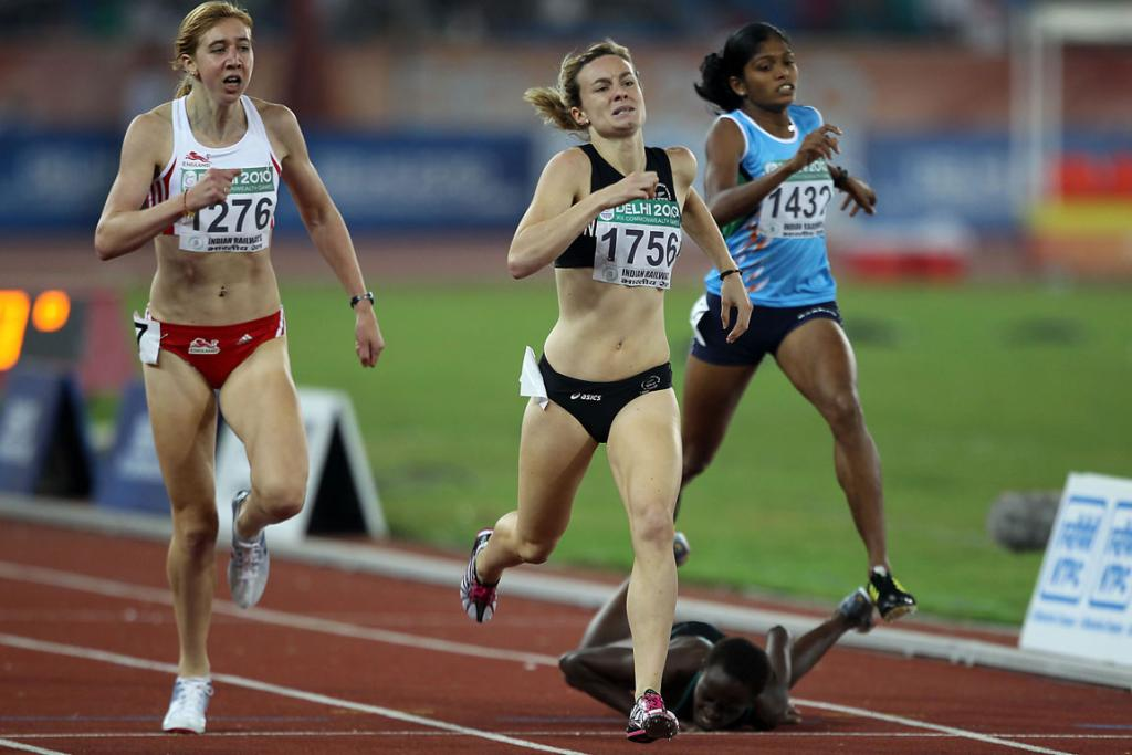 New Zealand's Nikki Hamblin stretches to grab the silver medal in the final of the women's 800m at the Commonwealth Games in Delhi.