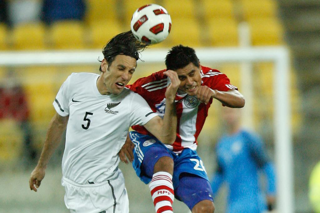 All White Ivan Vicelich heads the ball.