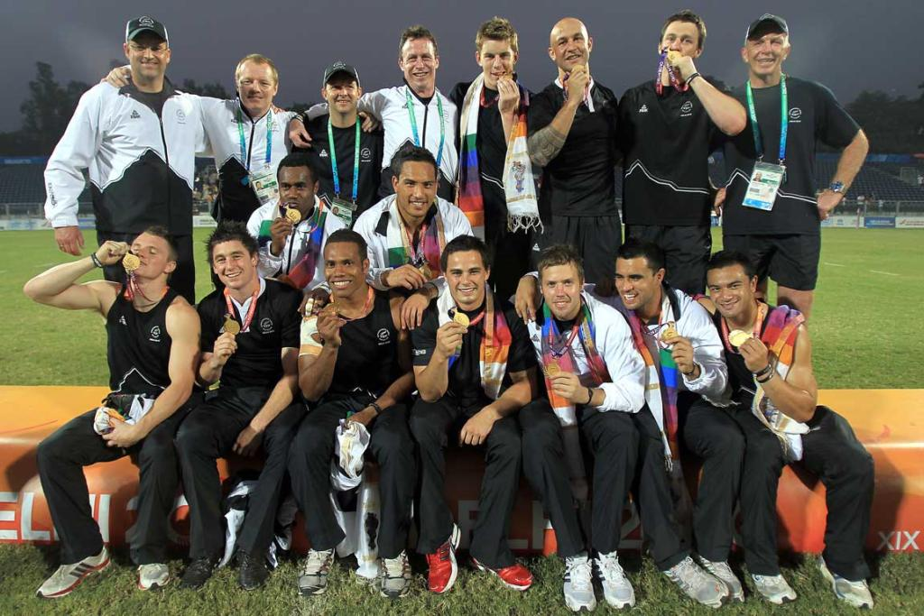 The New Zealand Sevens squad show off their gold medals after beating Australia in the Sevens rugby final at the Delhi Commonwealth Games.