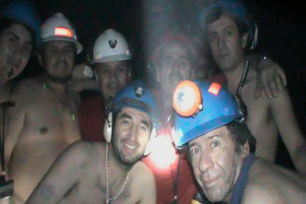 MAN CAVE: A frame grab shows miners trapped deep underground inside a copper and gold mine near Copiapo, Chile.