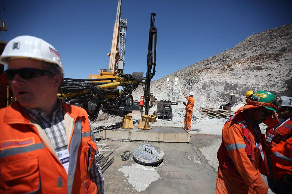 DIGGING DEEP: Austrian mine workers install the final platform where the winch that will hoist the trapped miners is being installed, hours before the rescue operation begins at San Jose mine in Copiapo.