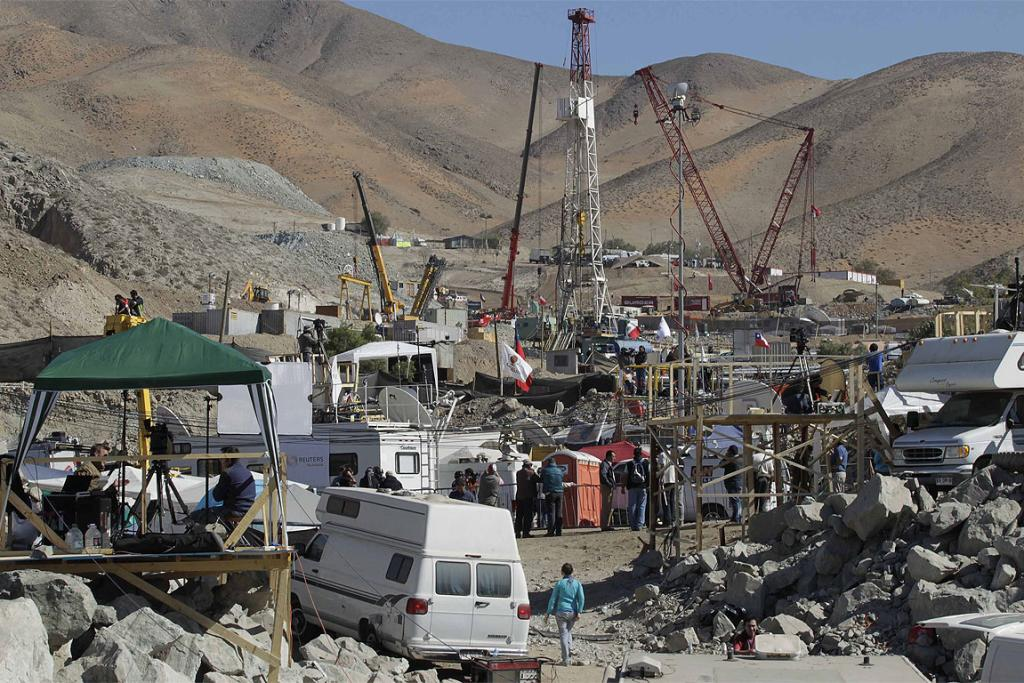 CAMPING OUT: A general view of the area at the San Jose mine with journalists vehicles in the foreground and the rescue area in the distance.