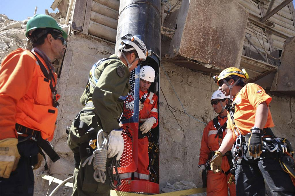 PRACTICE RUN: Members of the rescue team perform tests with the capsule before using it to lift the 33 trapped miners to safety.