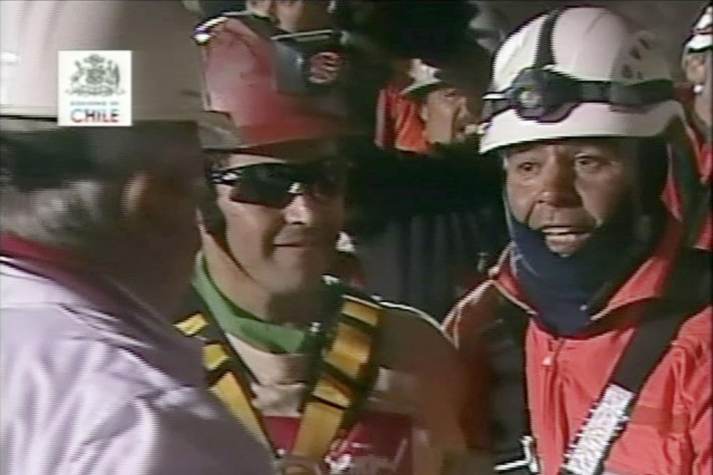 TASTE OF FREEDOM: Chilean miner Florencio Avalos immediately after being freed from his 69-days trapped underground.