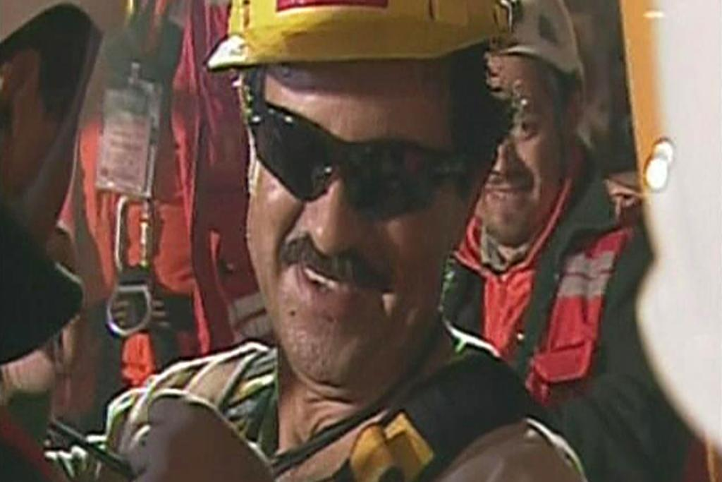 HIGH SPIRITS: A screengrab shows Juan Illanes, third of the miners to be rescued.