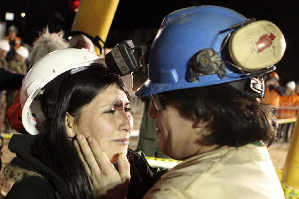 REUNITED: Osman Araya, the sixth miner to be rescued, greets his wife Angelica after 69 days underground.