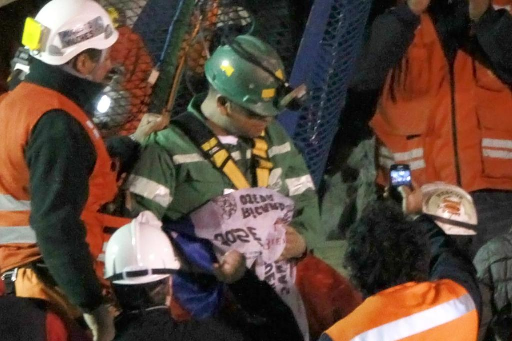 ABOVE GROUND: Veteran miner Jose Ojeda emerges from the Fenix 2 rescue capsule.