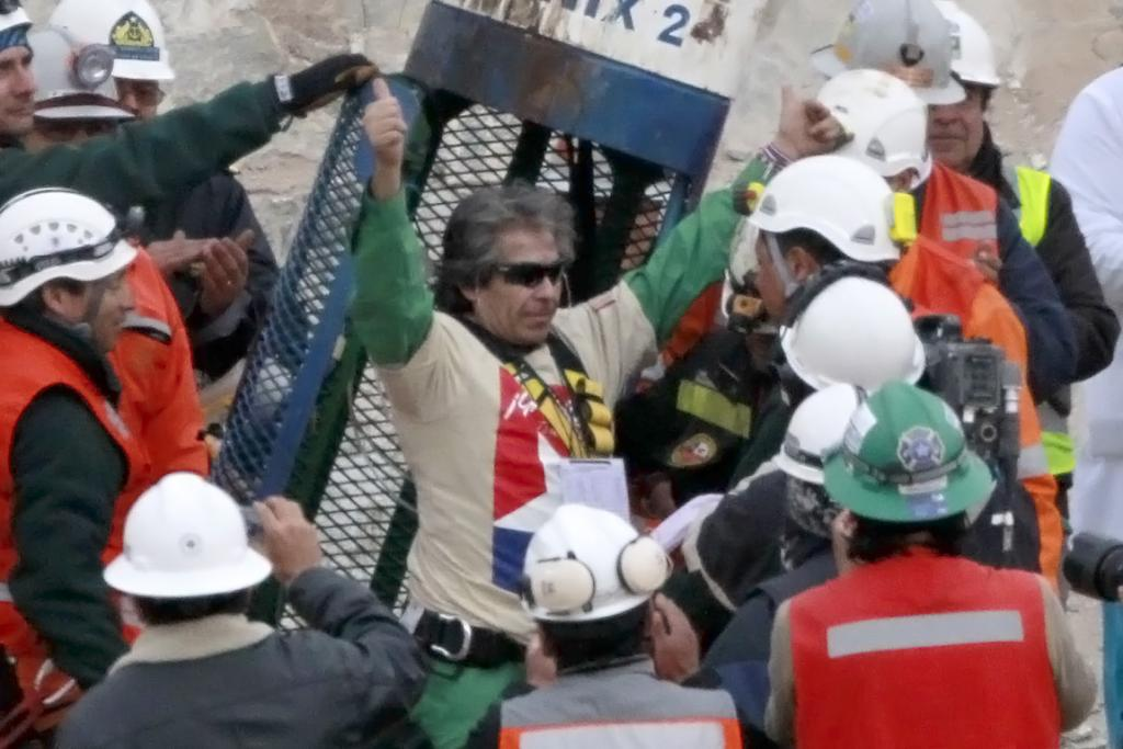 THUMBS UP: The oldest of the mining gang, Mario Gomez, gives a thumbs up as he exits the rescue capsule.