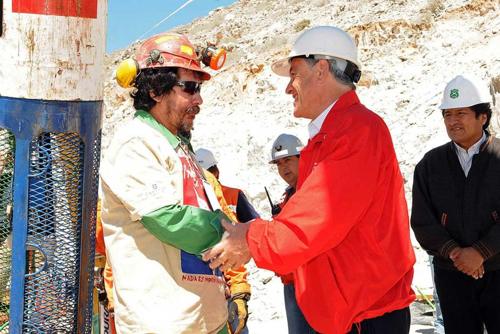 Victor Segovia is greeted by Chile's President Sebastian Pinera after reaching the surface to become the 15th to be rescued from the San Jose mine.