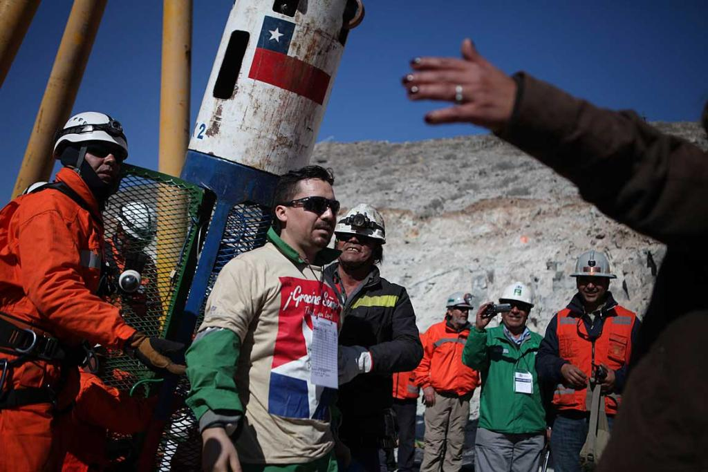 Edison Pena becomes the twelfth trapped miner to reach the surface in Copiapo.