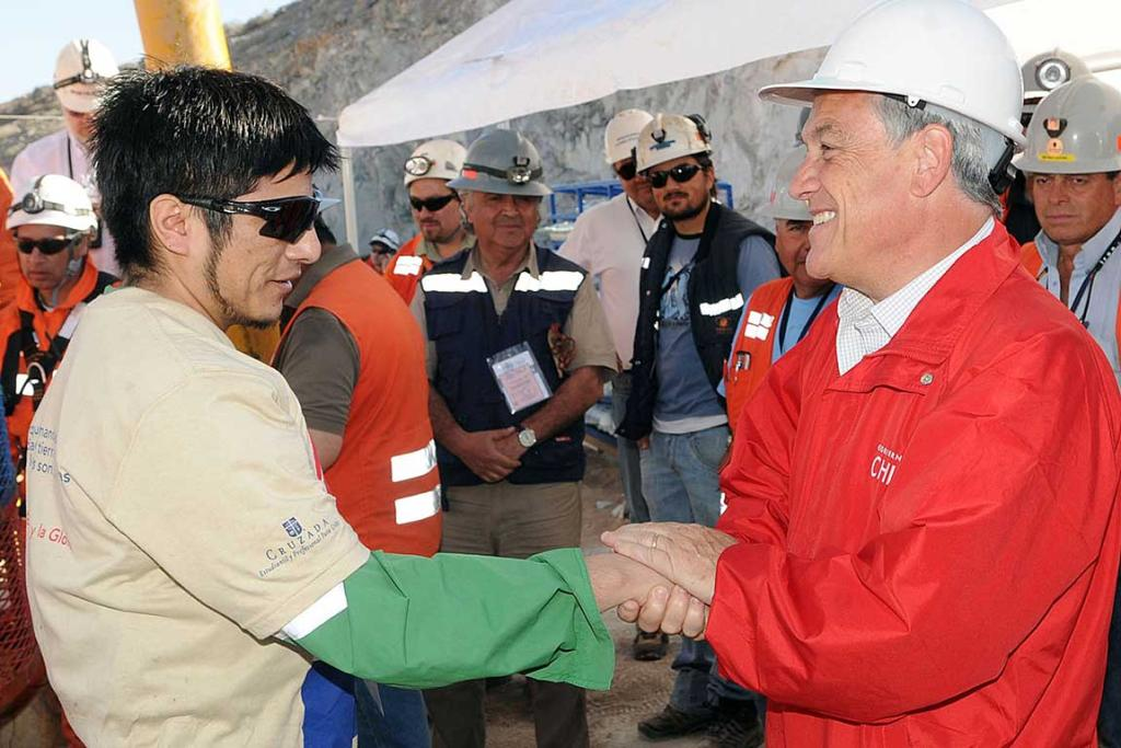 Carlos Bugueno is greeted by Chile's President Sebastian Pinera after reaching the surface.
