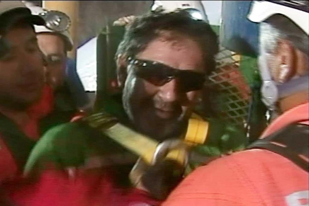 A video image taken on October 13, 2010 shows Luis Urzua, 54, the last of the 33 trapped miners, emerging out of Phoenix rescue capsule.