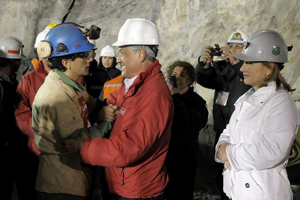 Raul Bustos, left, greets Chile's President Sebastian Pinera as first lady Cecilia Morel looks on.
