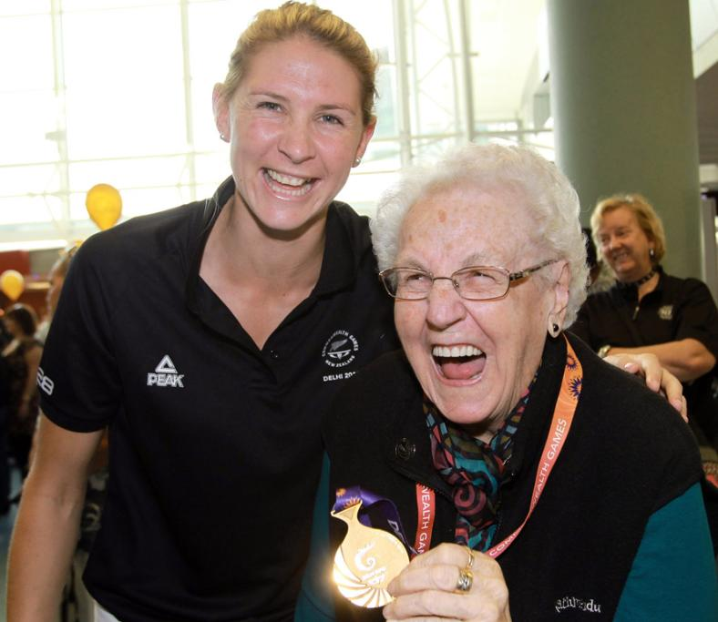 Silver Fern's Casey Williams with her grandmother Beryl Rusk as members of the New Zealand Commonwealth Games team arrive home in Auckland.