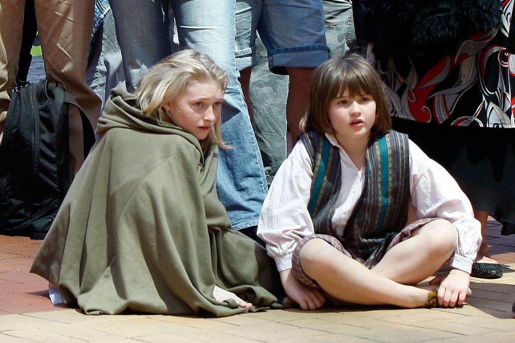 WHERE'S THE PRECIOUS? Meg Robinson and sister Kate Robinson enjoy the rally to support The Hobbit in Auckland.