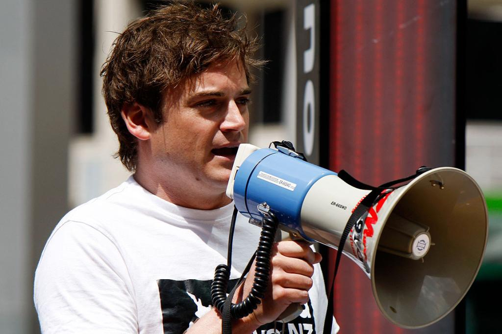 SAY IT LOUD AND PROUD: Hobbit rally organiser Mark Harrison speaks at QE2 Square in Auckland.