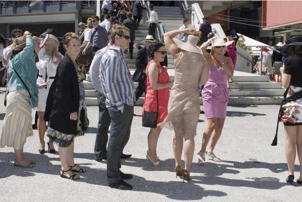Holding on to hats and dresses was a priority for some at the NZ Trotting Cup.