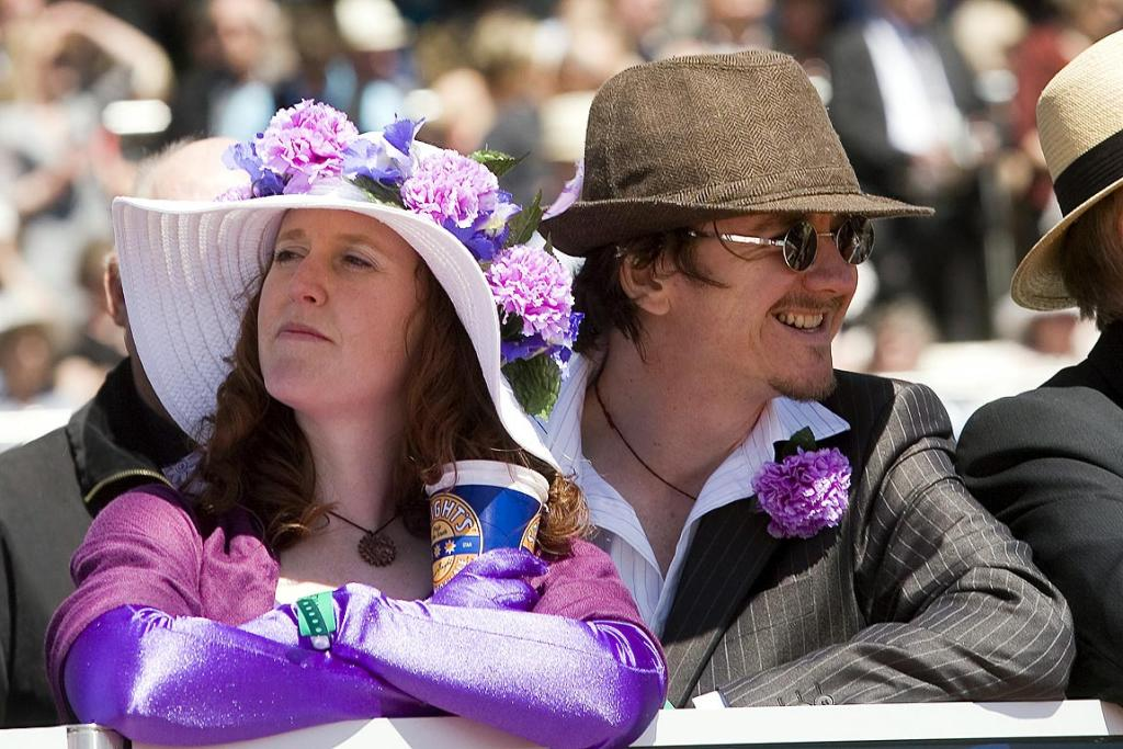 Mark and Gill Waterhouse of Diamond Harbour keep a close watch on proceedings at the NZ Trotting Cup.