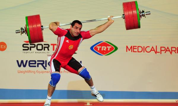 Ara Khachatryan, of Armenia, grimaces in pain after dropping his weights during the men's 85kg weightlifting competition at the World Weightlifting Championships in Antalya, Turkey.
