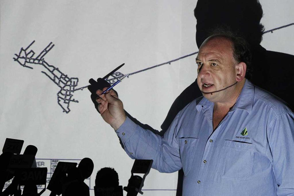 Pike River Coal chief executive Peter Whittall, shows a projected map of the mine at a media briefing.