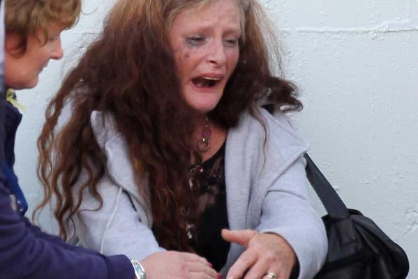 ANGUISH: A woman grieves after relatives were told the trapped Pike River miners were dead.