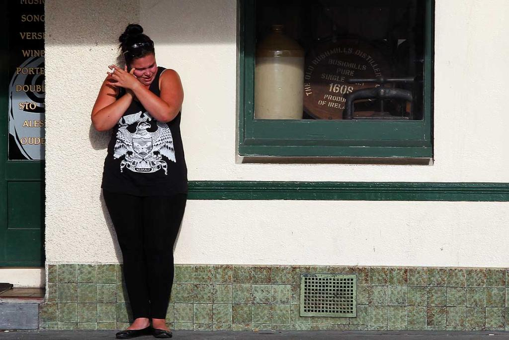 A COMMUNITY IN MOURNING: A woman outside Revingtons Hotel in Greymouth not long after hearing the miners were dead.